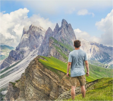 Man looking out onto mountain